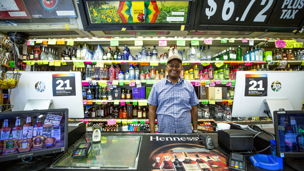 Haile Degena, owner of Royal Drug, stands in his shop at Bruce Randolph Avenue and York Street. July 22, 2020.