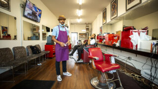 Patrick Efferson and Trae Riggs inside Exclusive Cuts Barber Shop on Bruce Randolph Avenue. Sept. 11, 2020.