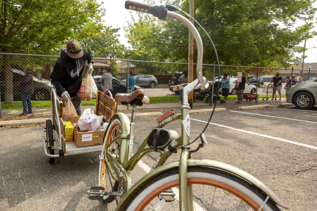 Ventura Rodriguez loads up his bike trailer with fresh offerings from Wyatt Academy's food pantry in Cole. Sept. 16, 2020.
