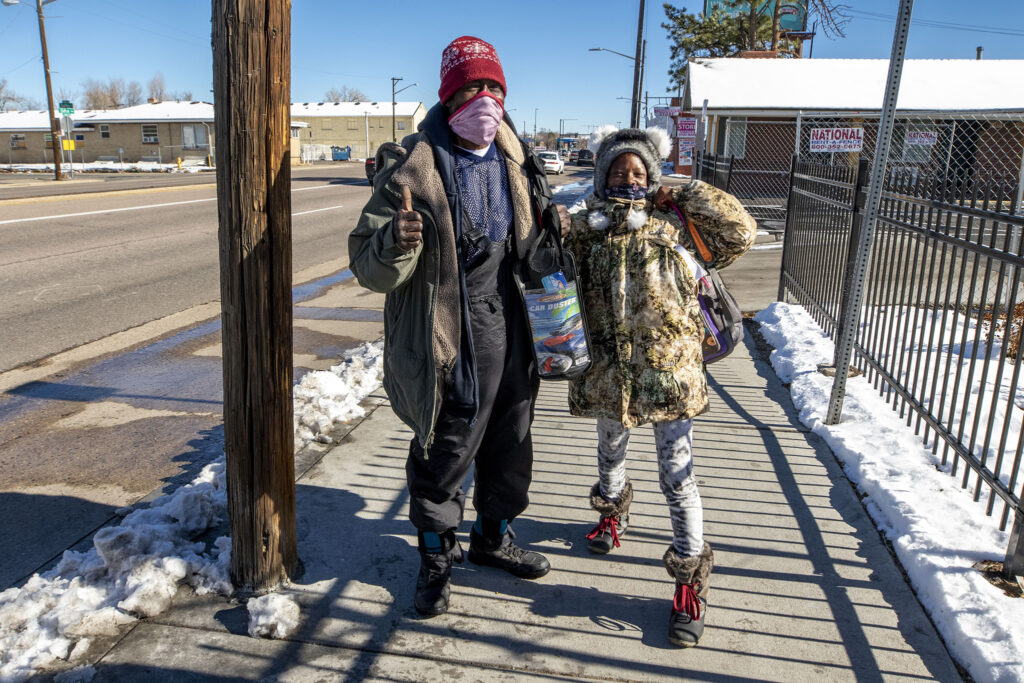 """Shelly Mack poses with her partner, Milton Bilton, on East Colfax Avenue on Nov. 25, 2020. I would like to see a shelter with a place where you can wash your clothes, and get ready for work in the middle of the day,"""" said Mack, who works but does not have a home of her own."""