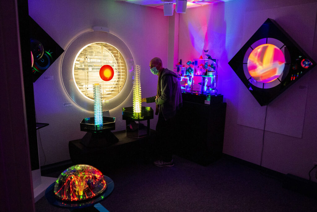 Barry Raphael tends to the sculptures inside the Lumonics Light and Sound Gallery in Denver's northern reaches. Dec. 1, 2020.