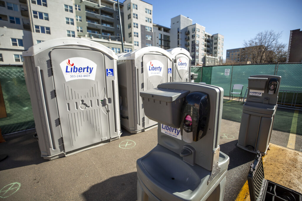 Mobile bathrooms stocked at Denver's first safe outdoor camping site, located next to First Baptist Church in Capitol Hill. Dec. 4, 2020.