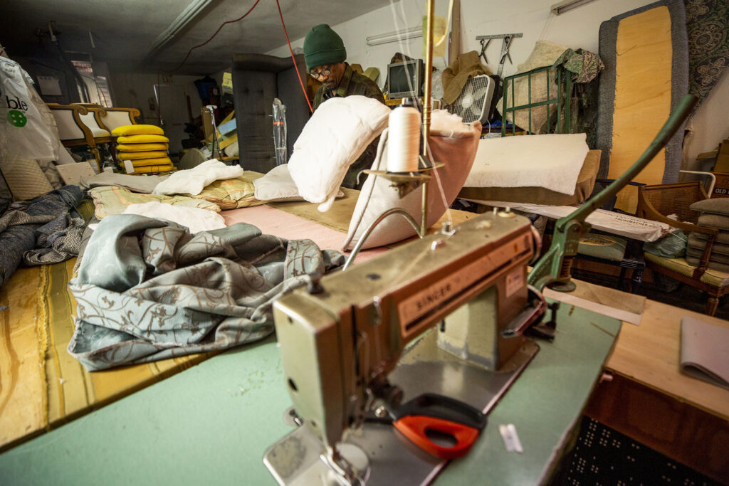 Vince Cox at work inside House of Blessing Custom Upholstery, his shop on 28th Avenue in Skyland. Dec. 4, 2020.