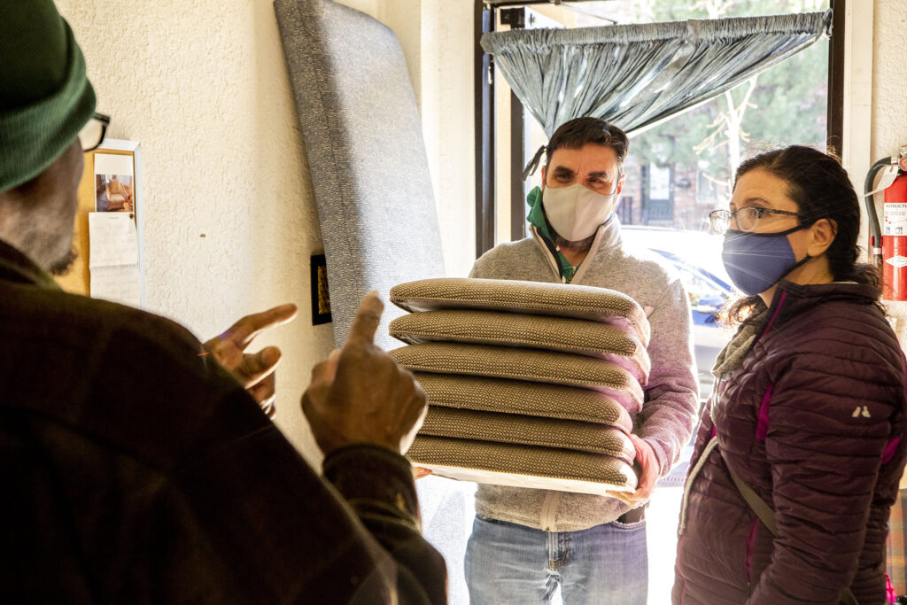 "Josh and Mia Allen pick up freshly-made pillows from Vince Cox's House of Blessing Custom Upholstery shop on Dec. 4, 2020. ""Merry Christmas and thanks for helping our family,"" Mia said. ""We are so happy to have found you."""