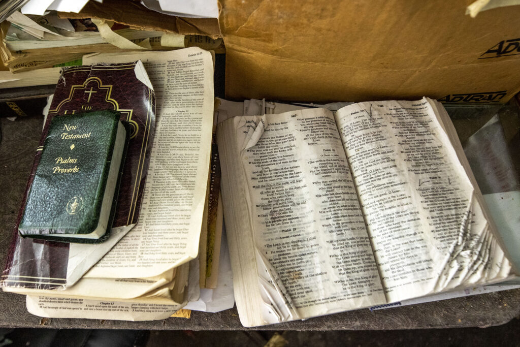 Vince Cox's open Bible, which he reads each morning, on a table inside House of Blessing Custom Upholstery, his shop on 28th Avenue in Skyland. Dec. 4, 2020.