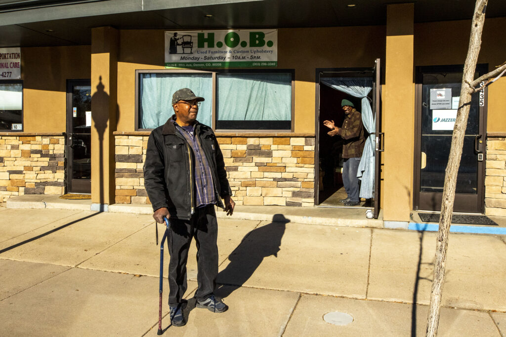 Vince Cox (right) and his friend and neighbor, Cowboy, outside of House of Blessing Custom Upholstery, Cox's shop on 28th Avenue in Skyland. Dec. 4, 2020.
