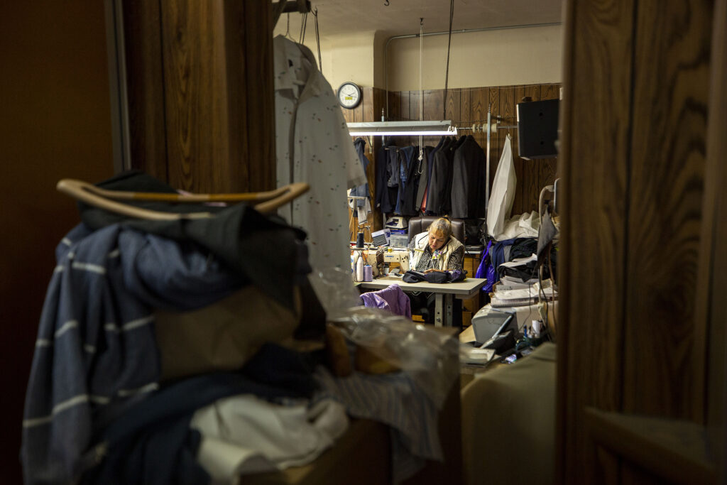 Marta Bolivar works a sewing machine at Duman's Custom Tailor on East Colfax Avenue. Dec. 9, 2020.