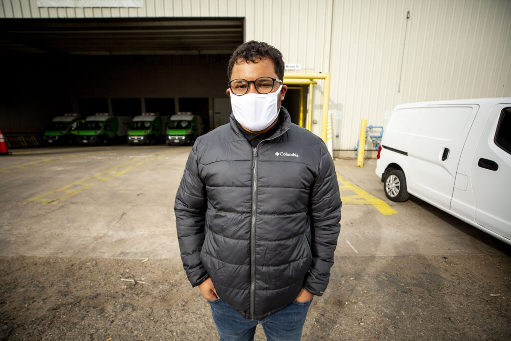 Bondadosa Chief of Staff Dom Barrera stands outside of a warehouse keeping Bondadosa's food supplies ready for delivery. Dec. 10, 2020.
