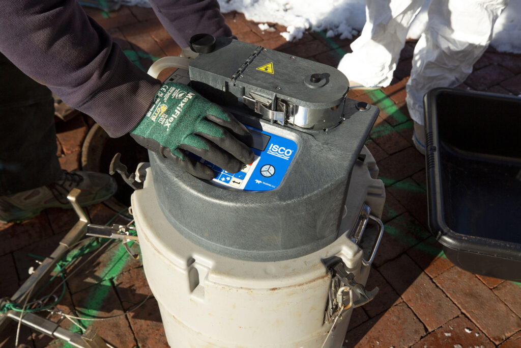 This wastewater sampler has lived inside a manhole by the University of Denver's Nelson Hall since September. It's now being taken out for service during winter break. Dec. 16, 2020.