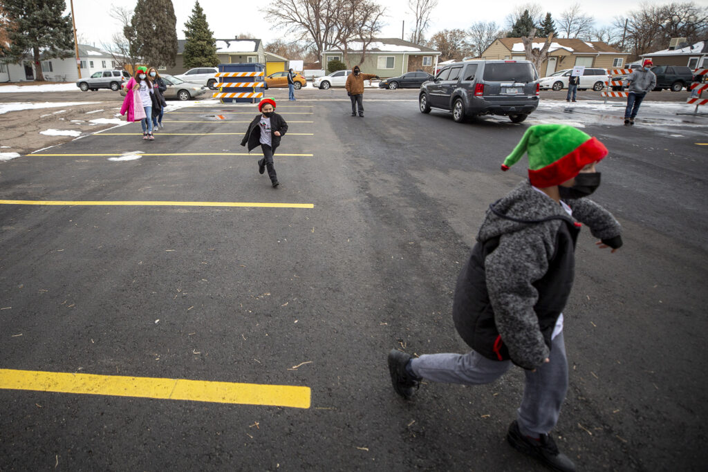 Kids frolic during Victory Outreach Church's annual toy giveaway in Athmar Park. Dec. 19, 2020.