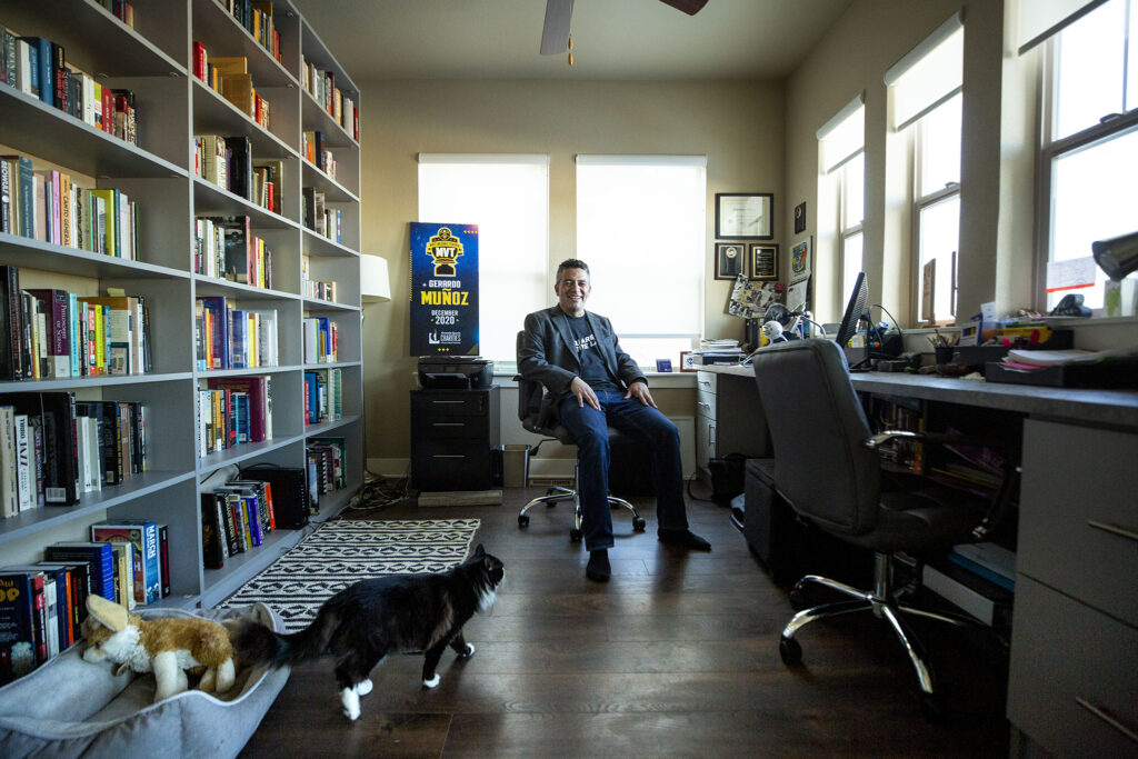 Gerardo Muñoz in his home office (with Frida the cat), where he's been teaching in 2020. Dec. 30, 2020.