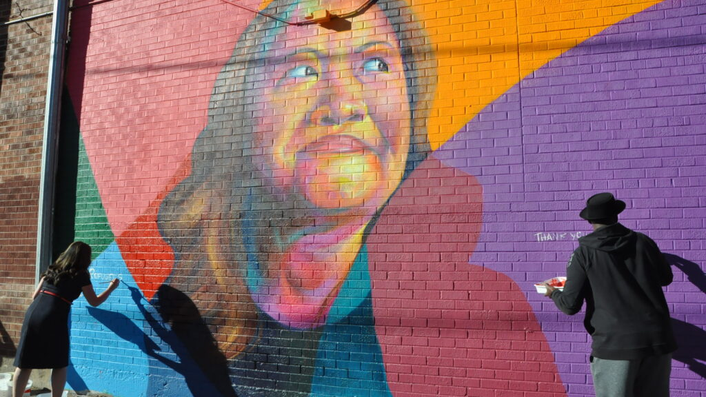 Thomas Evans' latest work at 24th and Curtis street in Five Points is a tribute to the work of activist Nga Vuong-Sandoval, a refugee who fled Vietnam with her family as a child — and who now advocates for the rights of other refugees and immigrants.