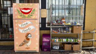 Base Coat salon's little free fridge and food pantry along Walnut Street in Five Points' RiNo art district. Jan. 5, 2020.