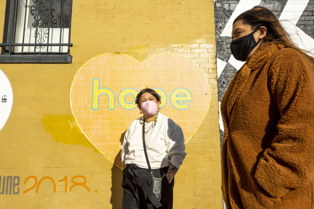 Tran Wills and Mariah Garcia stand outside of Base Coat, the salon that's now hosting a little free fridge along Walnut Street in Five Points' RiNo art district. Jan. 5, 2020.
