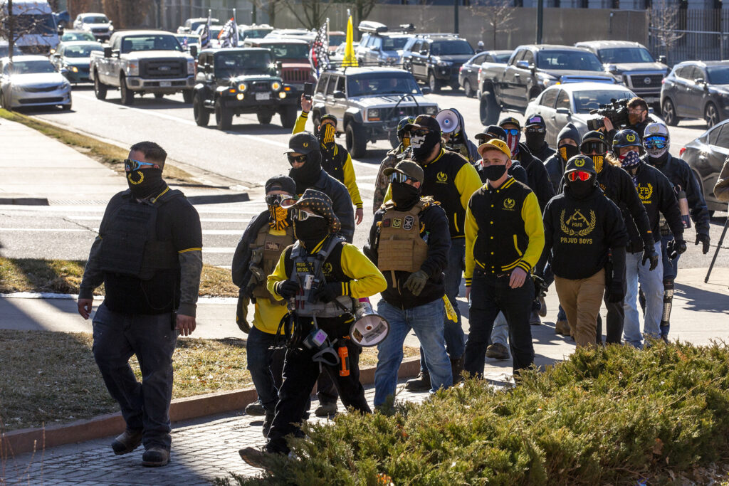 Proud Boys march into a rally in support of President Donald Trump in front of the Colorado State Capitol. Jan 6, 2021.