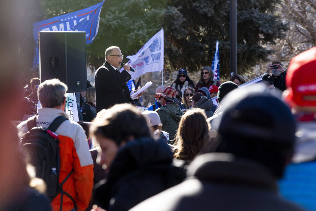 Jim Saunders preaches to people rallying in support of President Donald Trump in front of the Colorado State Capitol. Jan 6, 2021.