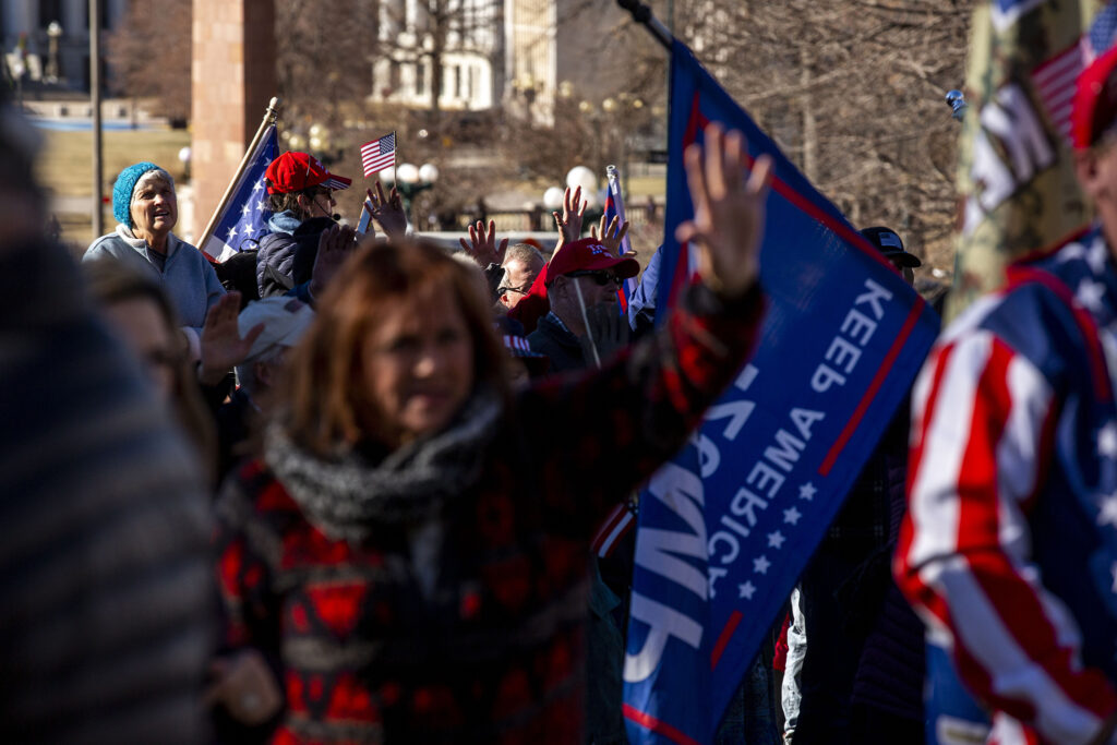 The crowd extends their hands toward the Colorado State Capitol in prayer during a rally in support of President Donald Trump. Jan 6, 2021.