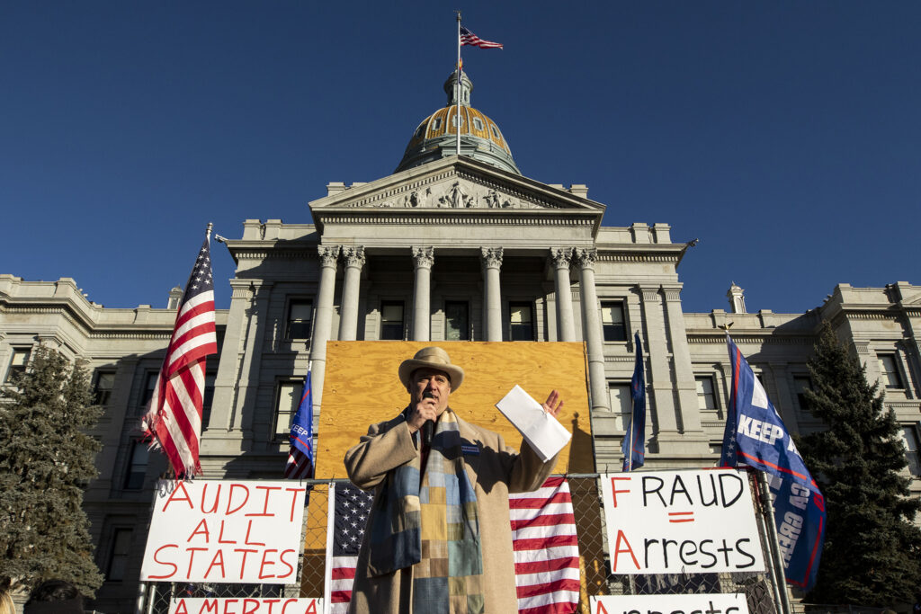 Steve Barlock, former GOP canditate and co-chair of Donald Trump's presidential campaign, speaks during a rally in support of the president in front of the Colorado State Capitol. Jan 6, 2021.