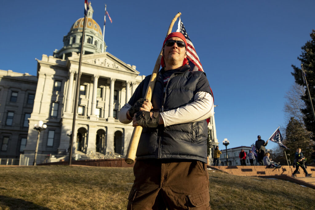 Law Johnston stands  in front of the Capitol during a rally in support of President Donald Trump. Jan 6, 2021.