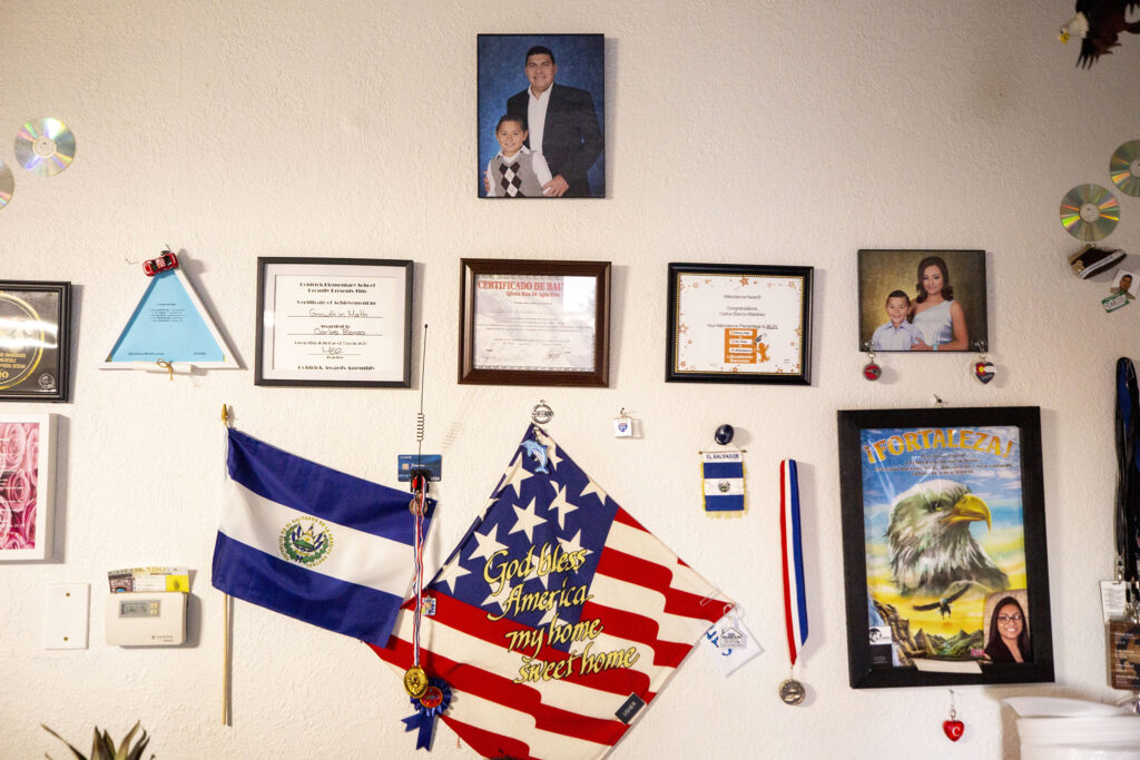 Awards and family photos on the wall of Yessenia Martinez and Carlos Blanco's Barnum home. Jan. 23, 2021.