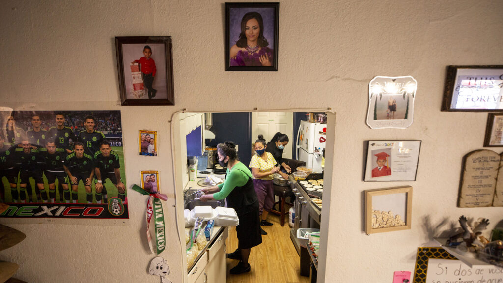 Lucy Castillo (left to right), Yessenia Martinez and Lupe Urquidez make pupusas in the kitchen of Martinez's Barnum home. Jan. 23, 2021.