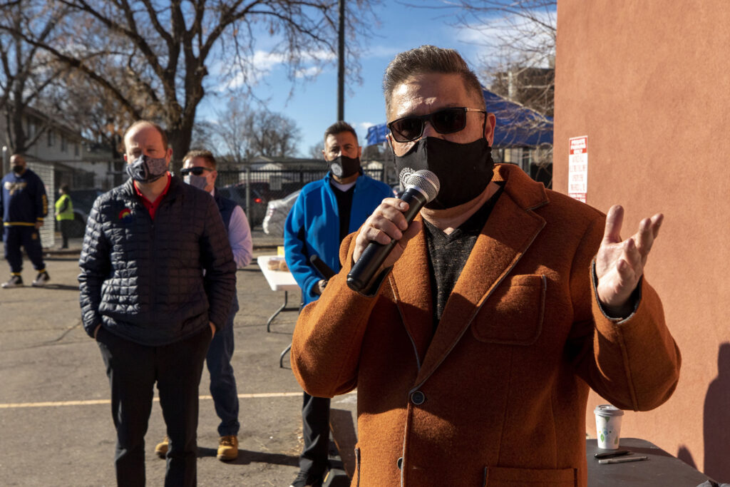 Servicios De La Raza Executive Director Rudy Gonzales speaks at a drive-through COVID-19 vaccine clinic set up in the nonprofit's parking lot in Denver's West Colfax neighborhood. Jan. 30, 2021.