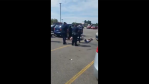 A screenshot from a cellphone video showing the incident between Aurora Police and Brittney Gilliam's family.