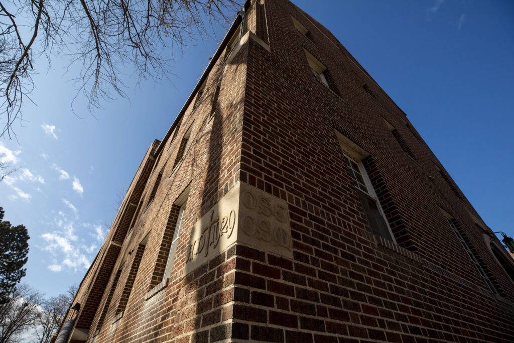 """A cornerstone reading """"1929"""" on the historic Pancratia Hall at Loretto Heights, which is being renovated and will soon become full of affordable housing units. Harvey Park South, Feb. 10, 2021."""