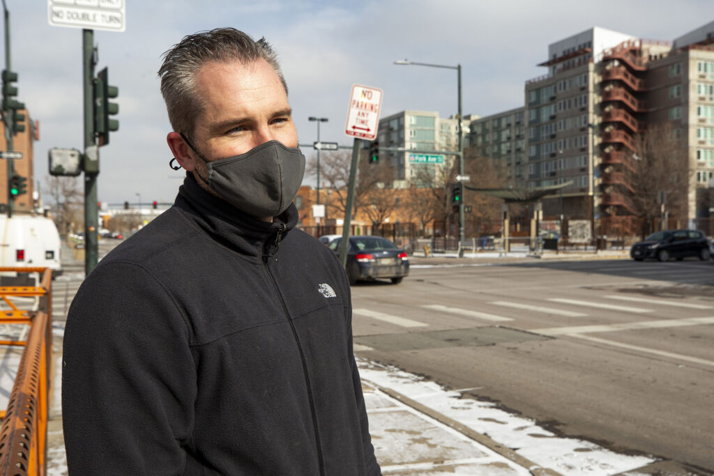 Mental Health Center of Denver case worker Chris Richardson stands outside of Denver's STAR van, which is parked by the Denver Rescue MIssion at Park Avenue and Lawrence Street. Feb. 12, 2021.
