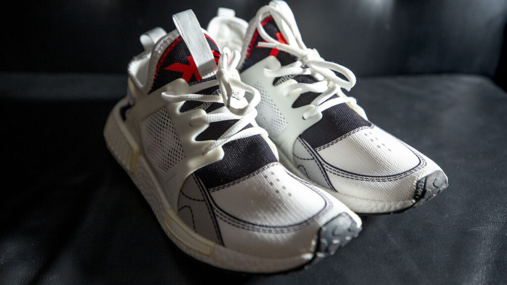 One of many pairs of Konctete Eden sneakers that Stephen McMillon and Anthony Porch hope to distribute to Denverites facing poverty. Feb. 13, 2021.