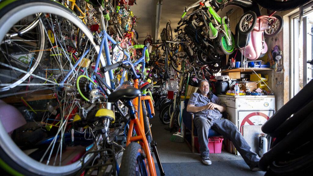 Thomas Padilla sits inside of his One Stop Bike Shop on Morrison Road. Feb. 23, 2021.