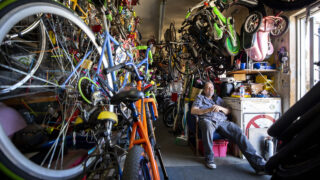 Thomas Padilla sits inside of his One Stop Bike Shop on Morrison Road. Feb. 23, 2021.