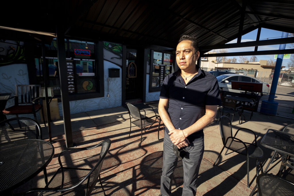 Noe Bermudez, owner of Kahlo's Mexican restaurant on Morrison Road, stands beneath the patio covering installed by a city program during the pandemic. Feb. 23, 2021.
