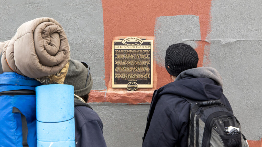 """A historic marker in LoDo that details the """"Chinese Riot of 1880."""" Feb. 25, 2021."""