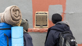 "A historic marker in LoDo that details the ""Chinese Riot of 1880."" Feb. 25, 2021."