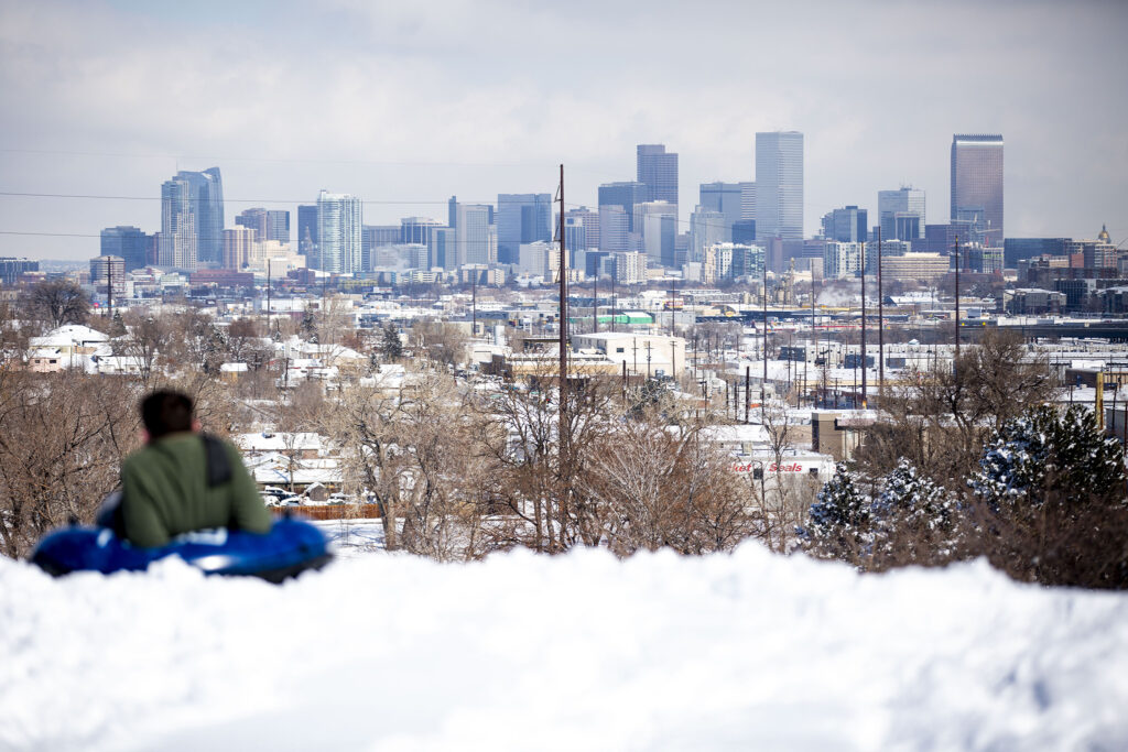 Grayson Goodman gazes out at the city on a break from tubing Denver's Ruby Hill. Feb. 25, 2021.
