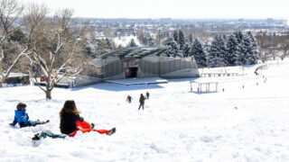 Kids sled the big hill at Ruby Hill in Denver. Feb. 25, 2021.