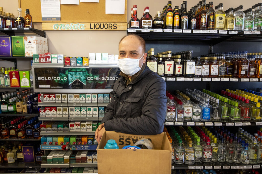 Raju Gautam owns  Oneida Liquors on the 2200 block of Oneida Street in South Park Hill. He said business has been slow, since people aren't holding big parties at home and, especially, because the Broncos haven't been doing so well. Feb. 4, 2021.