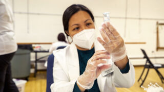 Nhung Mai draws out a COVID-19 vaccine at a city-run clinic inside the Barnum Recreation Center. March 10, 2021.