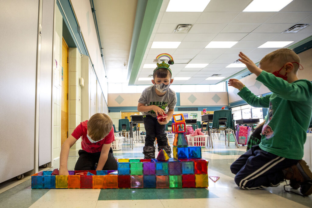 Kindergarteners Hayden (right to left), Mac and Nate build a space station out of magnetic blocks during Carson Elementary's Discovery Link after-school program. March 17, 2021.