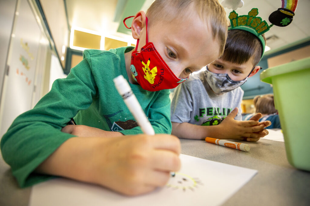 Kindergarteners Nate (left) and Mac draw scary scarecrows during Carson Elementary's Discovery Link after-school program. March 17, 2021.