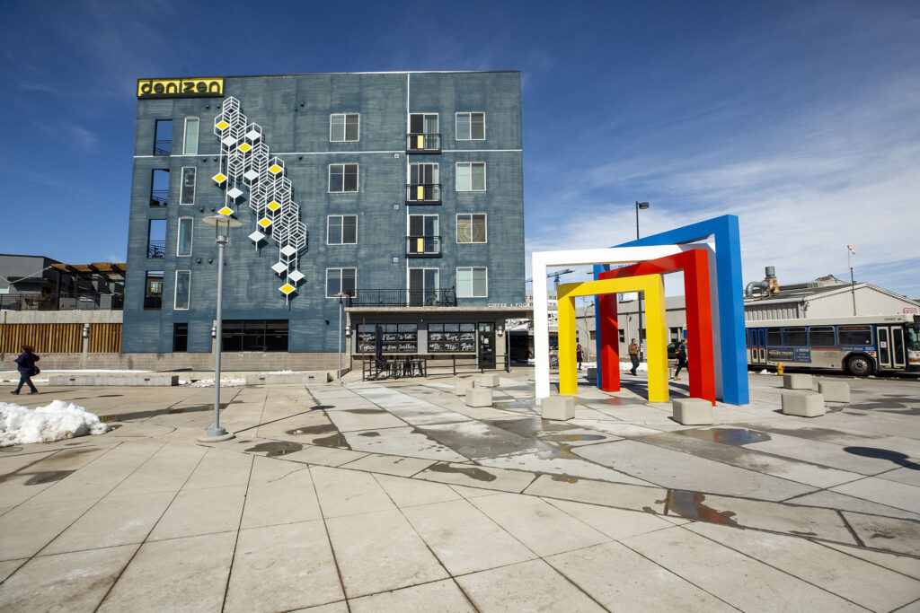 """Four Chromatic Gates,"" a sculpture devised by Herbert Bayer, has been fully realized in an installation at RTD's Alameda Station. The Denizen apartments behind it employ Bayer's style, which he learned in his time at the Bauhaus school of design in Germany. March 18, 2021."