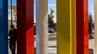 "Herbert Bayer's ""articulated wall"" can be seen through the posts of his ""Four Chromatic Gates,"" which was recently installed at RTD's Alameda Station at South Cherokee Street and West Alaska Place. March 18, 2021."