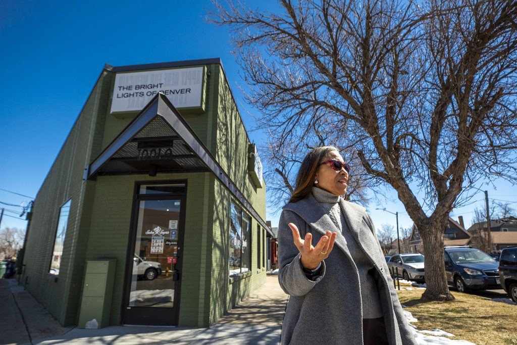 Yvette Freeman stands outside the building where her great uncle once owned a hat and clothing shop near the heart of Five Points. March 19, 2021.