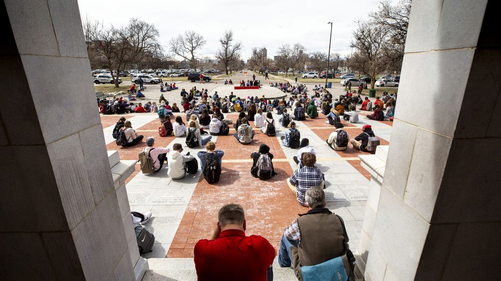 East High School students sit for five minutes of silence during a walk-out in solidarity with Boulder on Thursday afternoon. March 25, 2021.