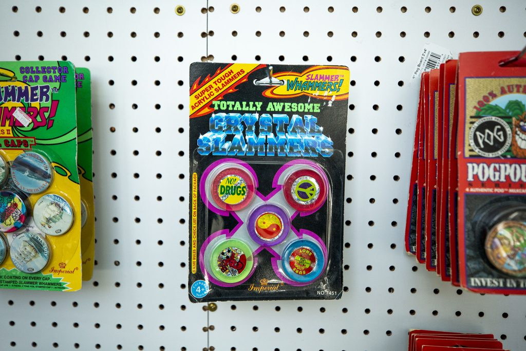"Unwrapped, ""totally awesome"" pog slammers on display at the Denver Pog store, now installed at Understudy Denver, the experimental arts space beneath the Convention Center steps. March 30, 2021."