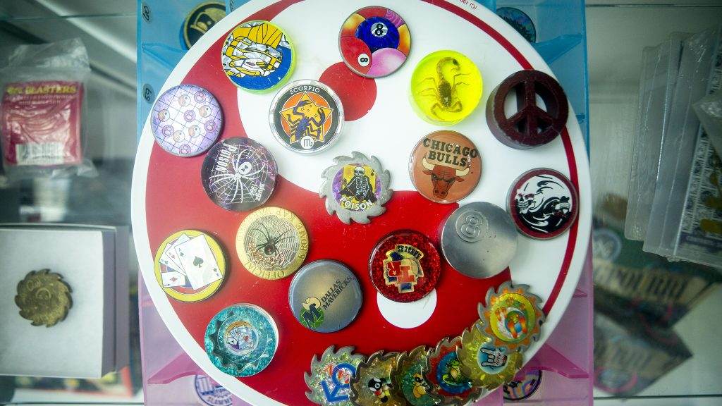 Rare slammers in a display case at the Denver Pog store, now installed at Understudy Denver, the experimental arts space beneath the Convention Center steps. March 30, 2021.