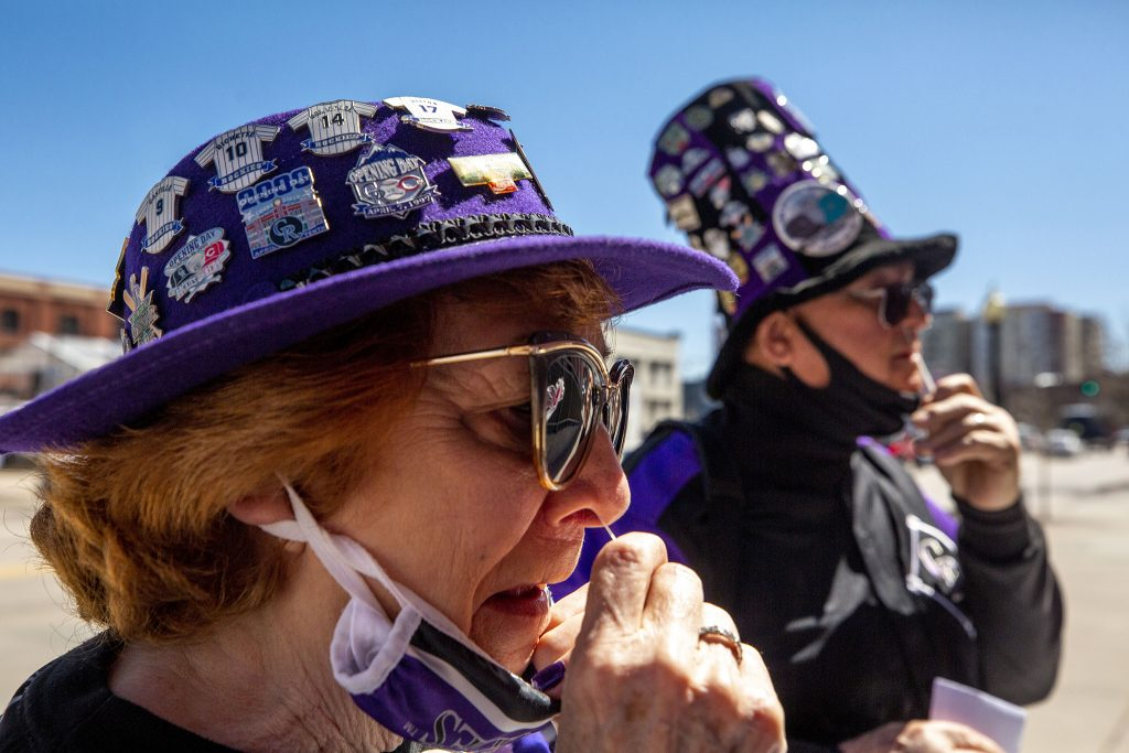 Bill and Linda Ragland are both vaccinated, but they took a free COVID-19 test outside of Coors Field anyway before they found their seats for opening day. April 1, 2021.