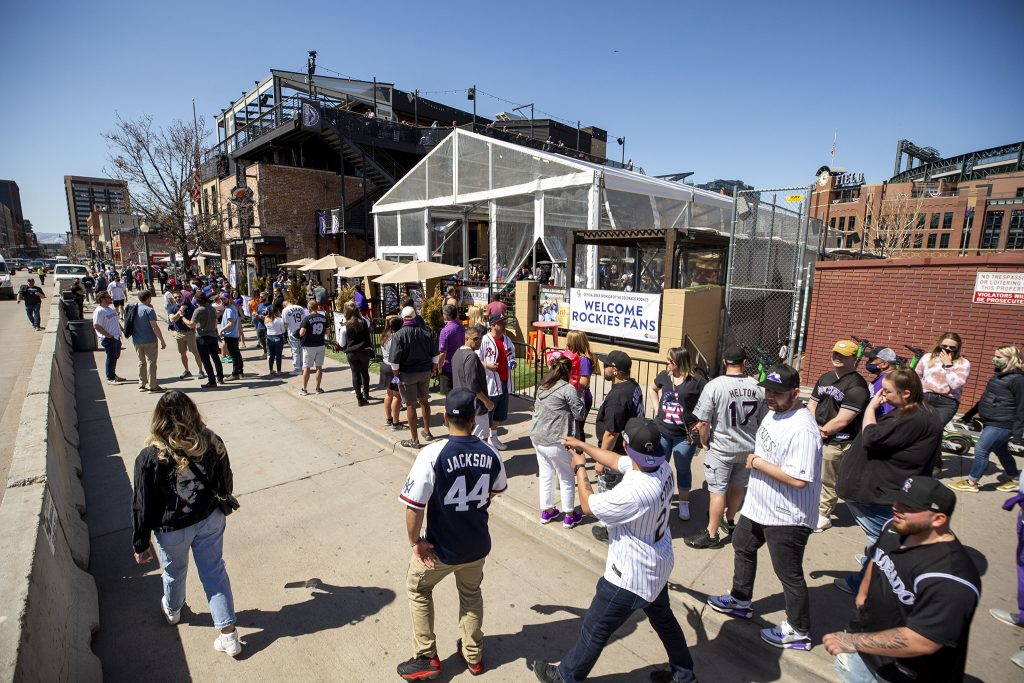 Crowds line up to enter View House for to drink and watch the Rockies face off against the Los Angeles Dodgers on opening day. April 1, 2021.