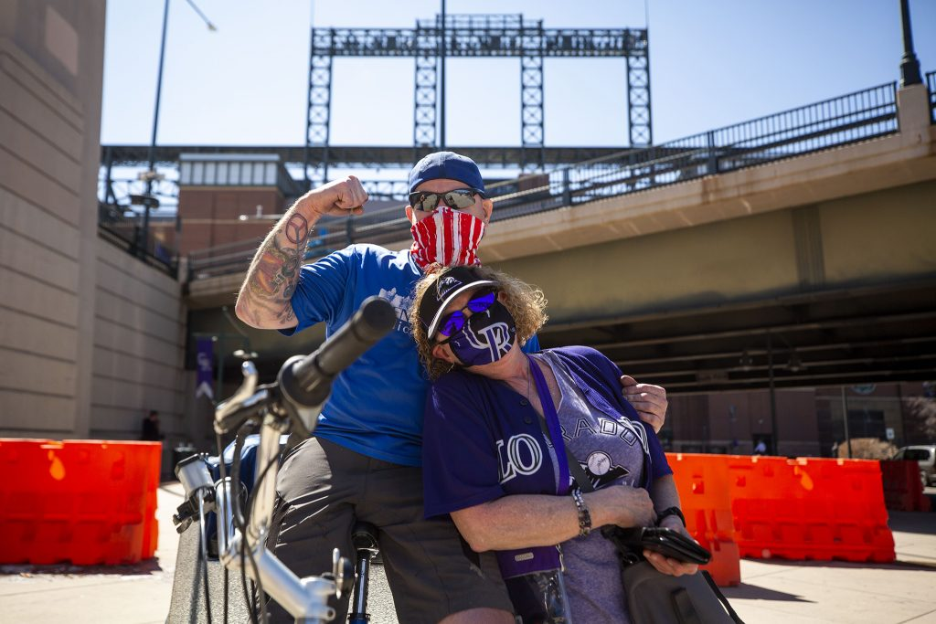Pedicab driver Brian McGinn reunited with Candy Lepore, a longtime customer, as Lepore arrived at Coors Field for Opening Day. April 1, 2021.
